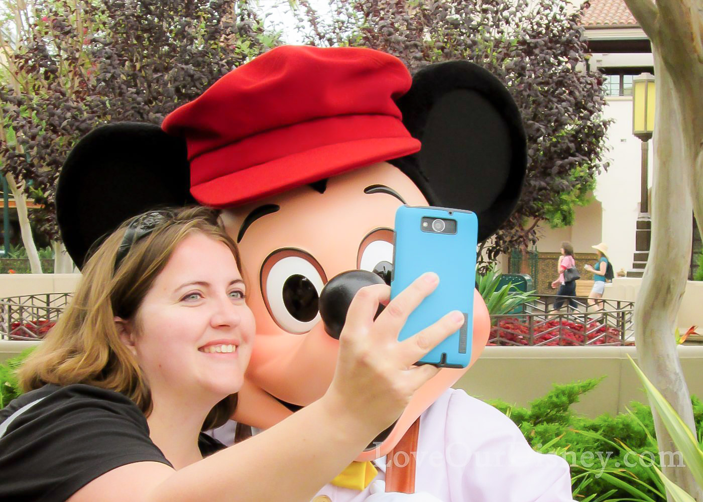 Disneyland With Kids admin Becca Taking Selfie with Mickey Mouse